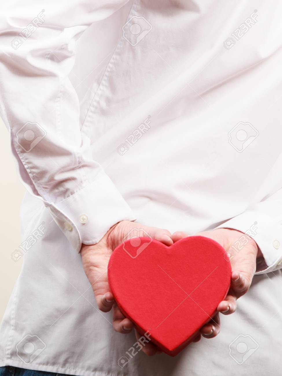 Closeup Of Man Holding Heart Shaped Gift Box Surprise Present