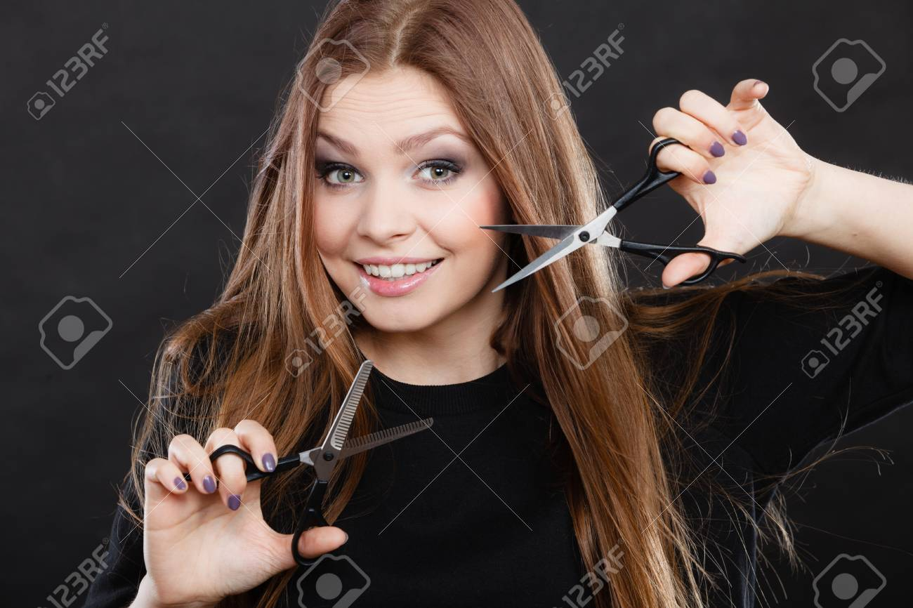 stock photo style and fashion professional hairstylist barber with new idea of look changing long haired woman with scissors creating hairdo coiffure