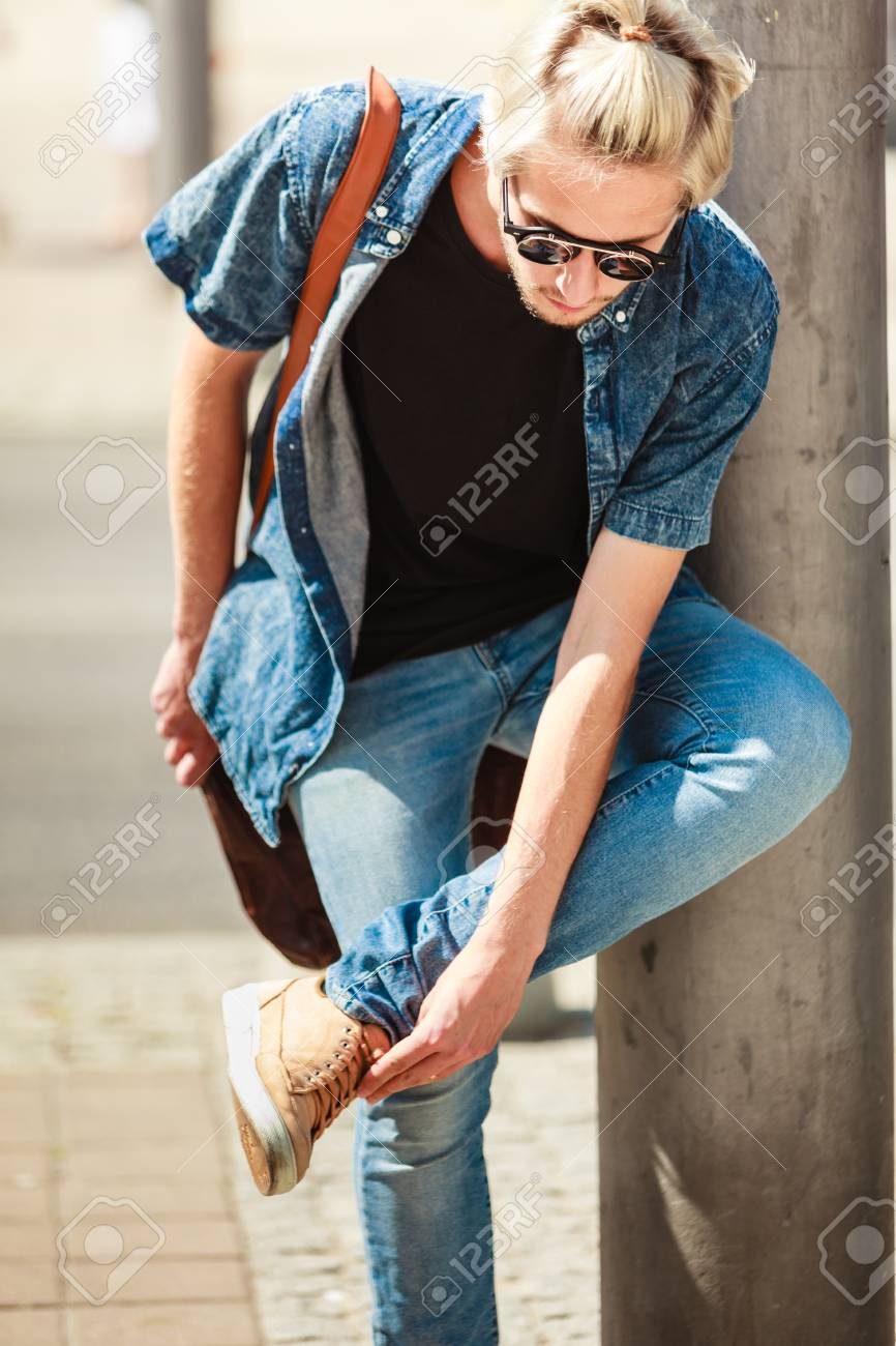 Men fashion, urban style clothing concept. Hipster guy walking..