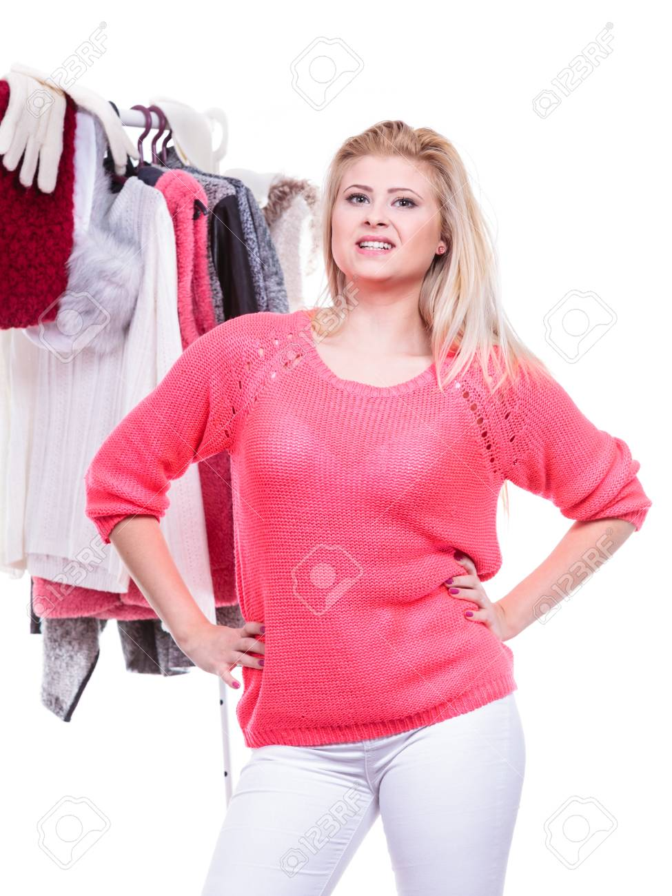 clothing fashion on closet wardrobe photo blonde girl her warm teen home rack choosing outfit young woman in indecision stock