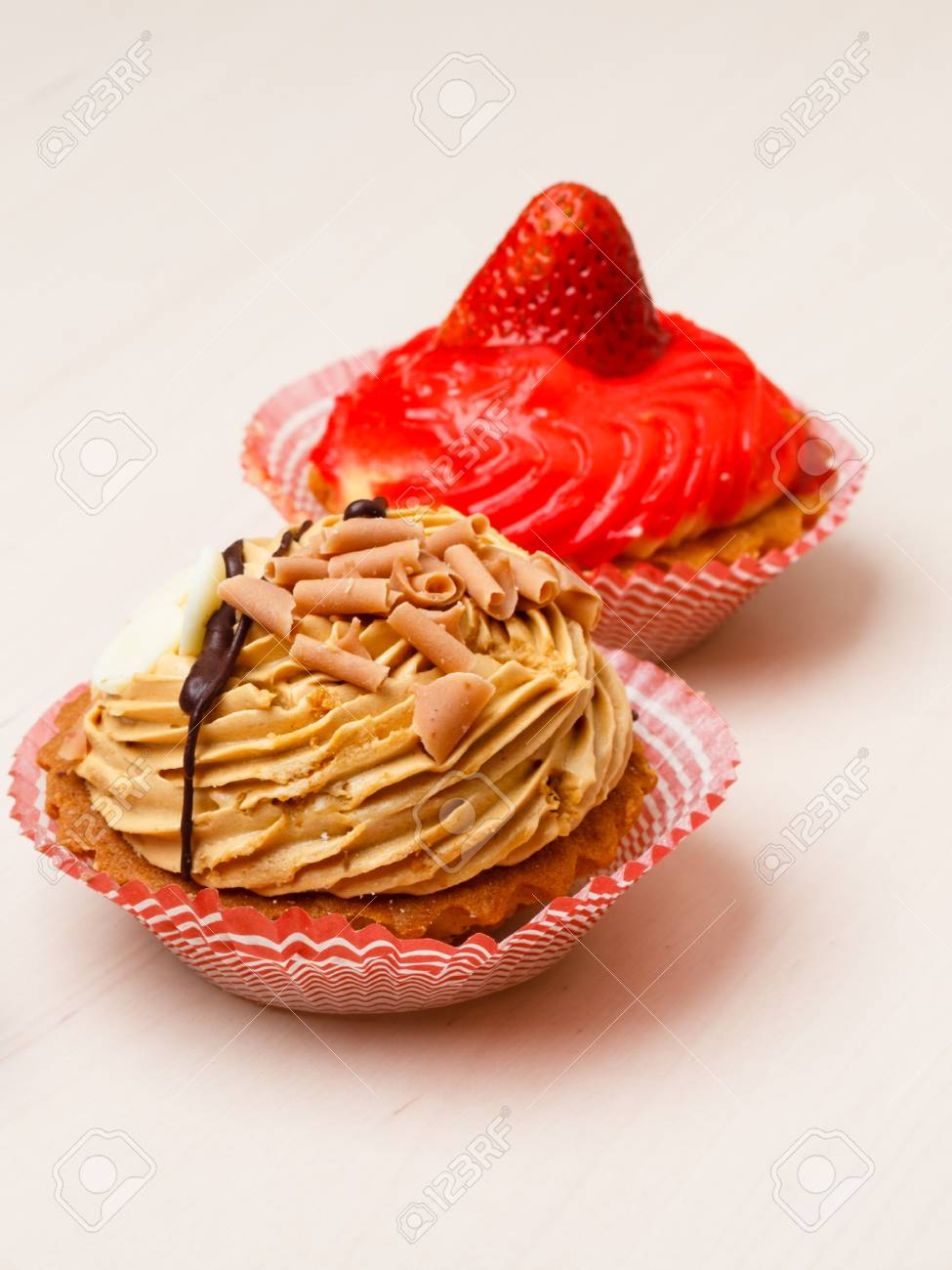 Gourmet Tasty Cakes Cupcakes With Cream And Fruit Decoration As