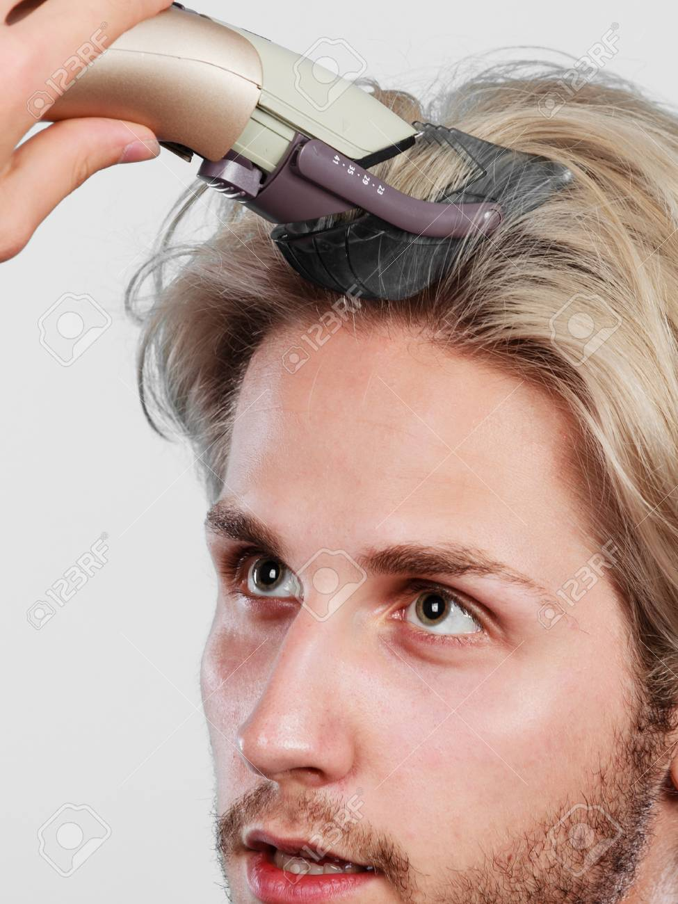 Hairdo hairstyle concept cool male hairstylist making self trendy hairdo hairstyle concept cool male hairstylist making self trendy haircut fashion blonde metrosexual model winobraniefo Image collections