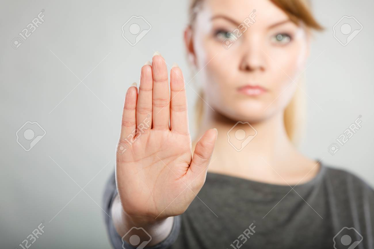 Communication psychology negative defensive concept. Assertive woman making stop gesture. Strong blonde lady showing hold sign. - 106645468