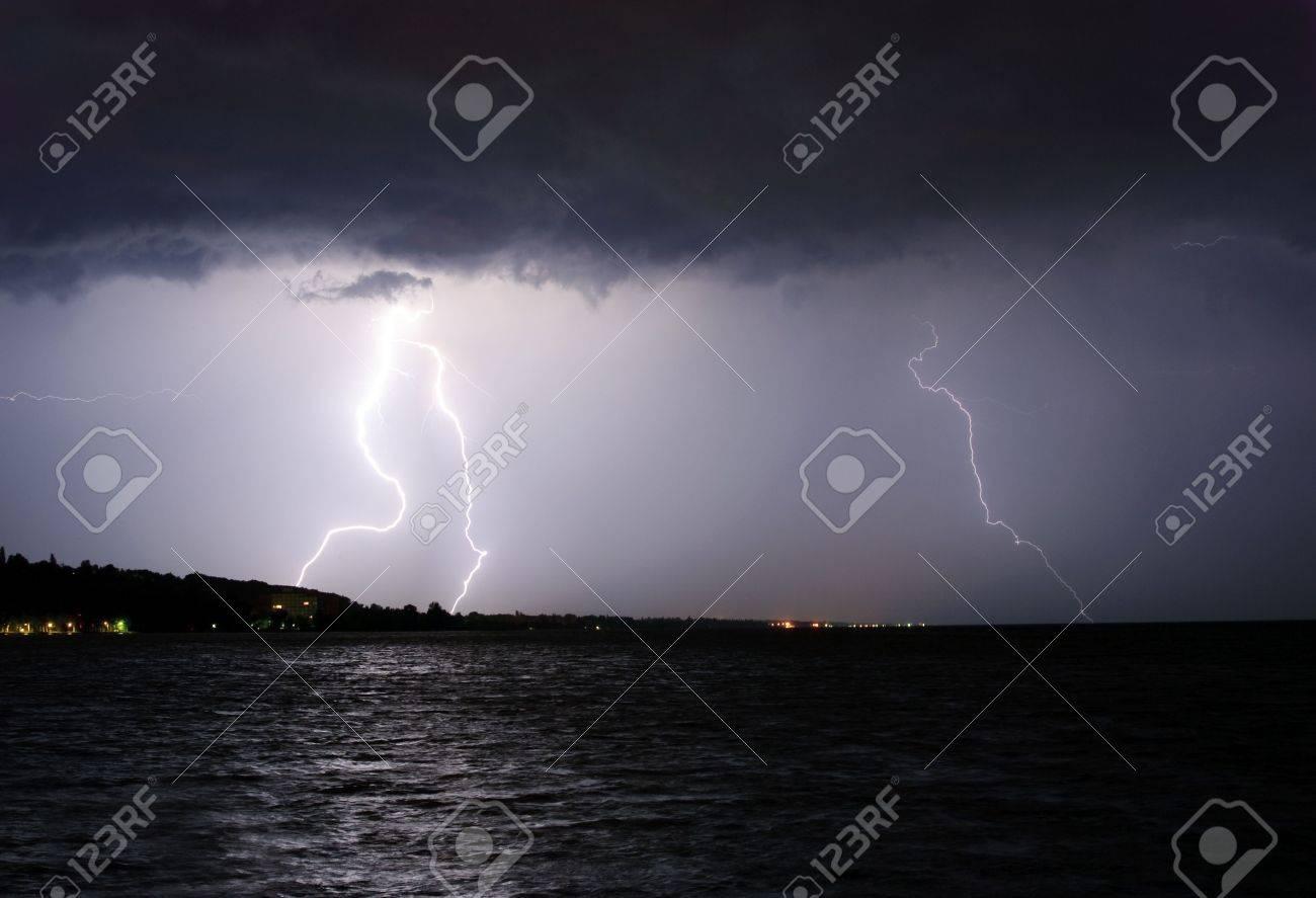 Lightning above the lake Stock Photo - 5324739