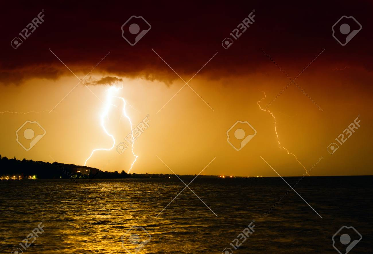 Lightning above the lake Stock Photo - 13876713