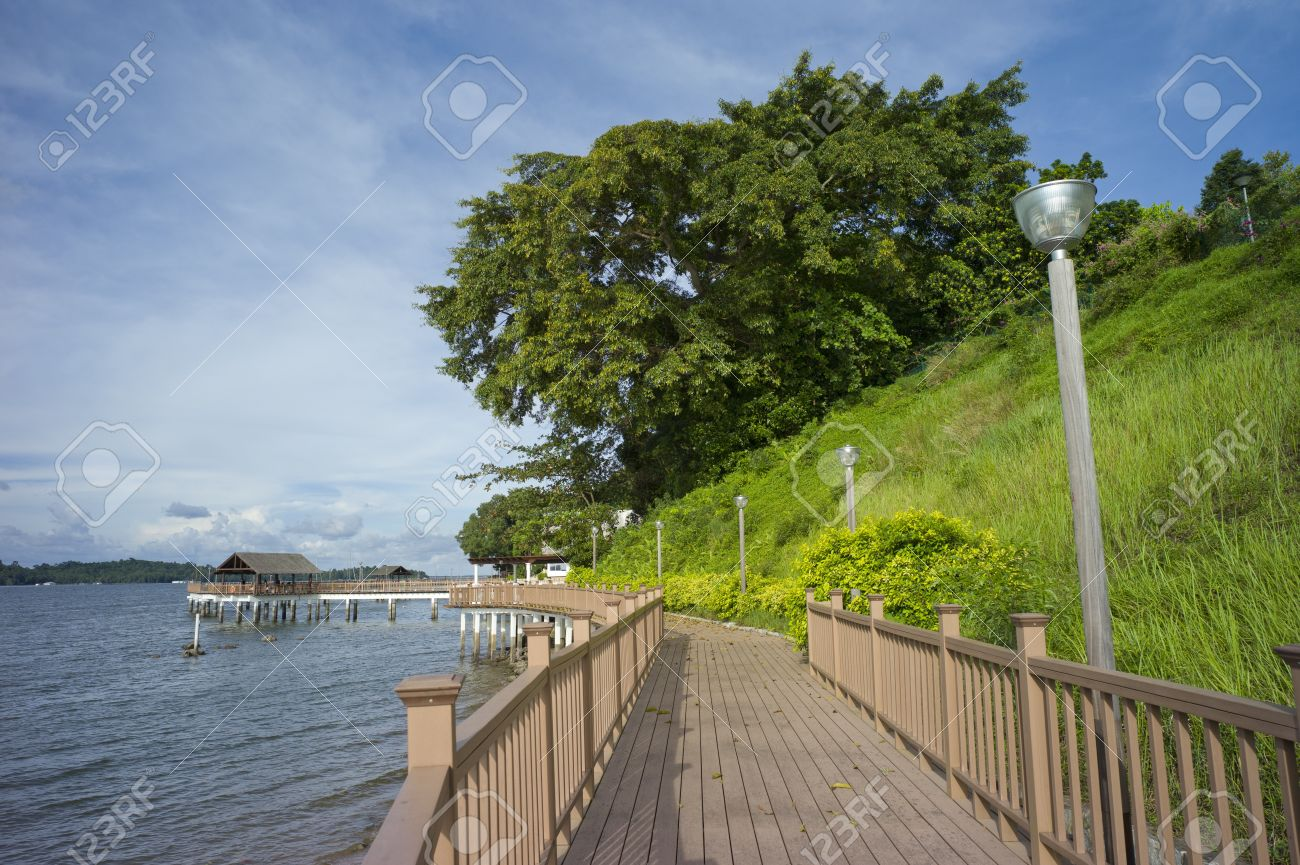 Board walk along Changi Beach located at the eastern part of Singapore - 11138959