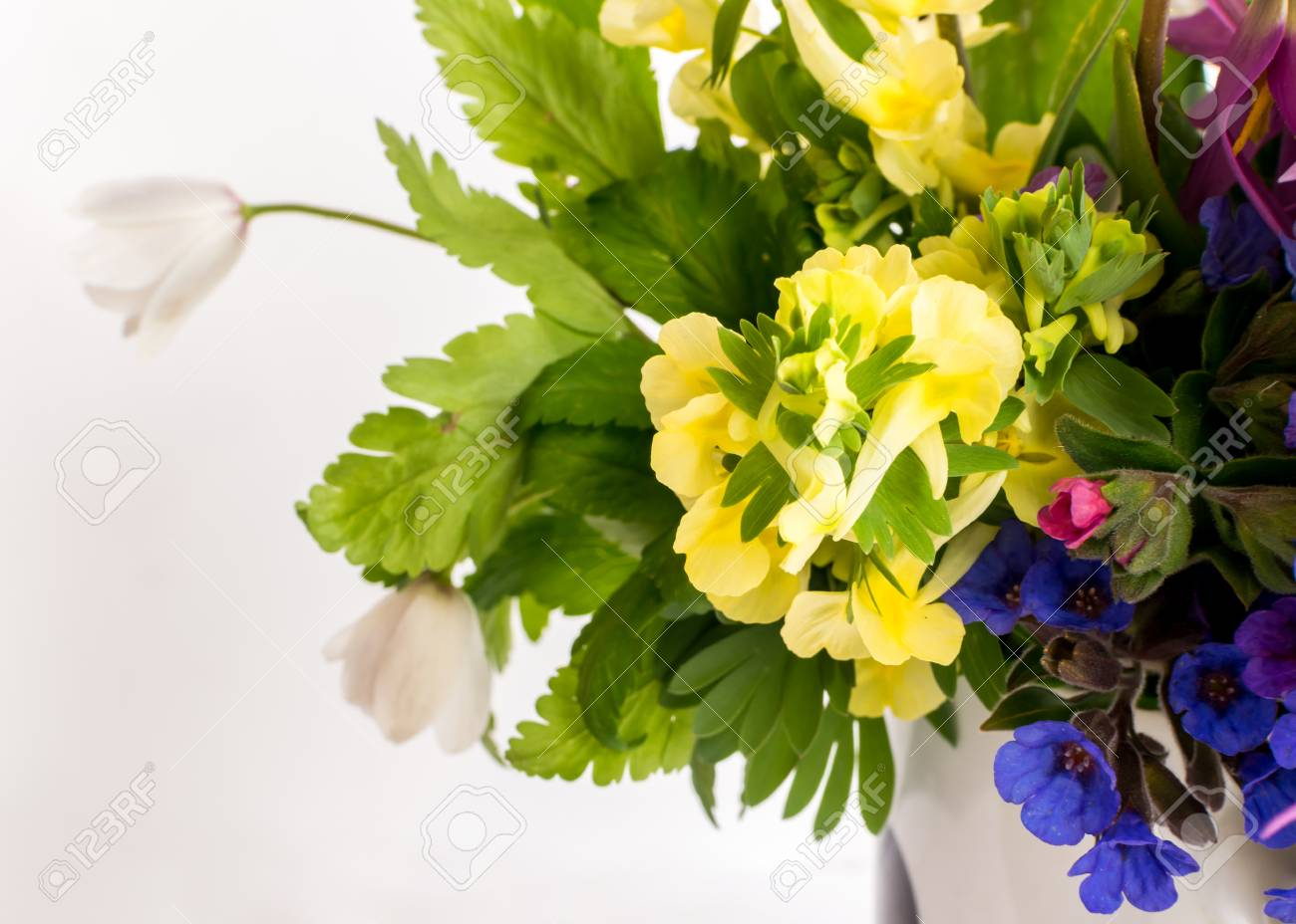 Beautiful Spring Flowers Bouquet. Yellow, Blue, White And Purple ...