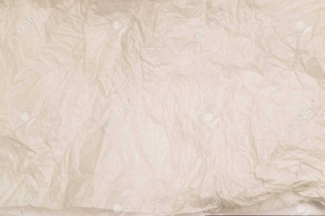 crumpled or creased paper texture. empty wrinkled sheet of paper
