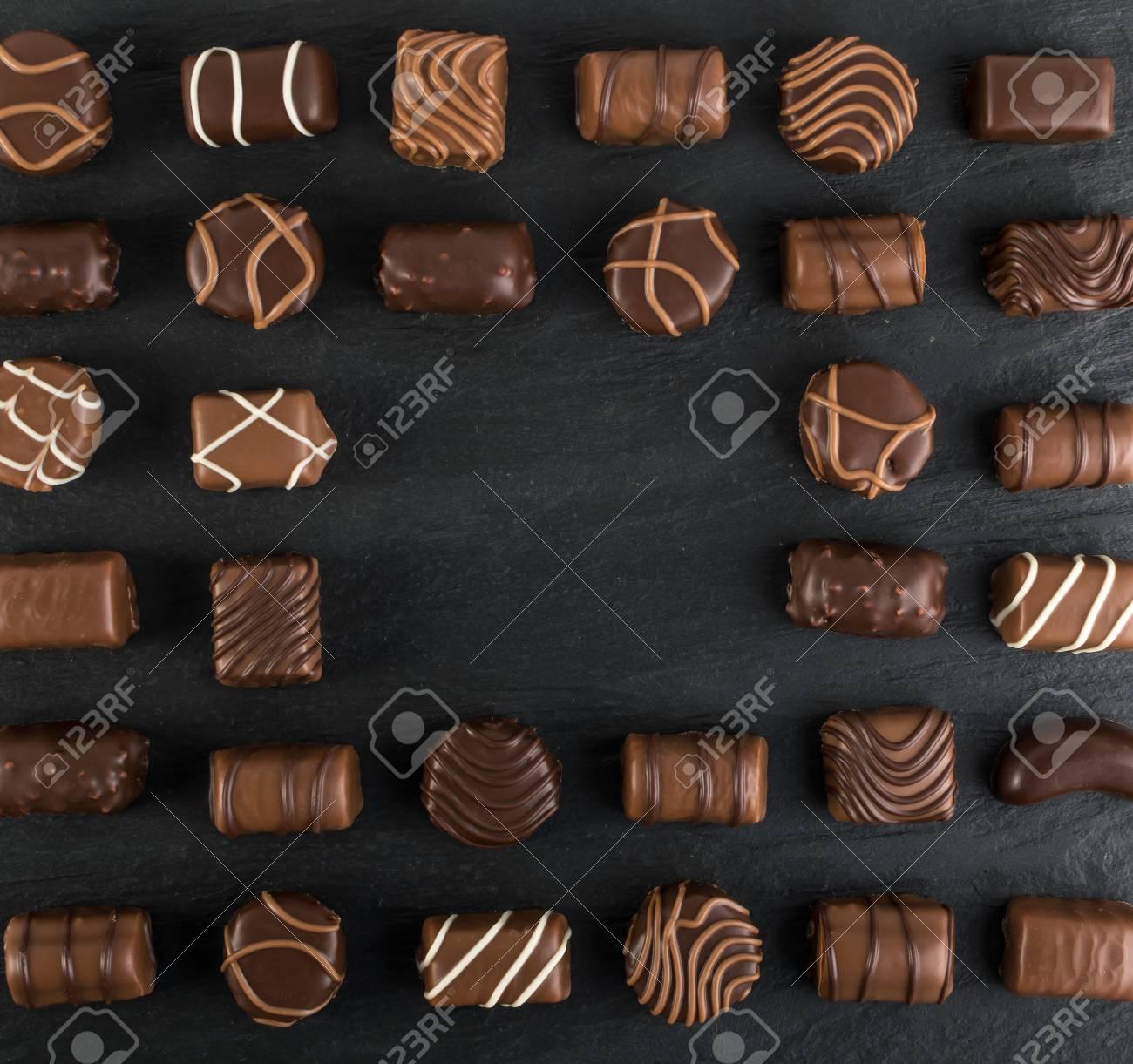 Beautiful Creative Chocolate Sweets On Natural Black Stone