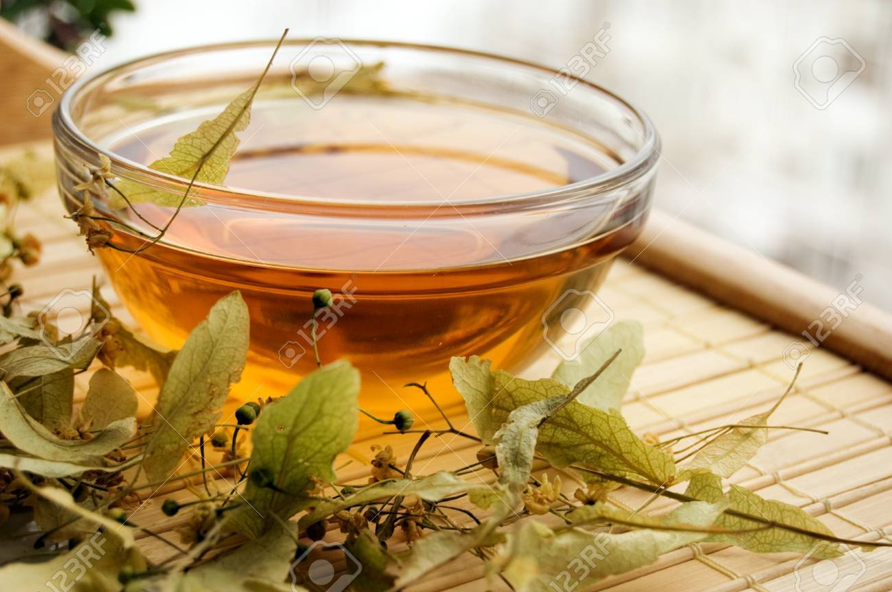 Cup of tea from dry lime-tree flower Stock Photo - 7456073