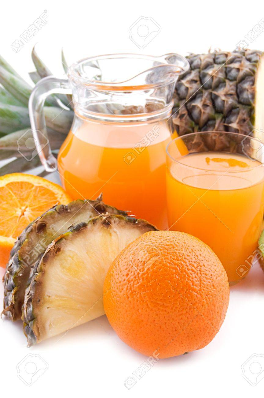 Jug and glass of multivitamin juice with ananas and orange Stock Photo - 9334605