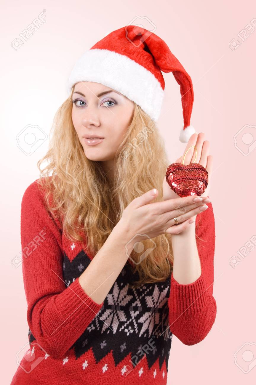 Woman In Santa Hat Holding Red Heart Over Light Red Back Stock Photo ... 062b6d1b859