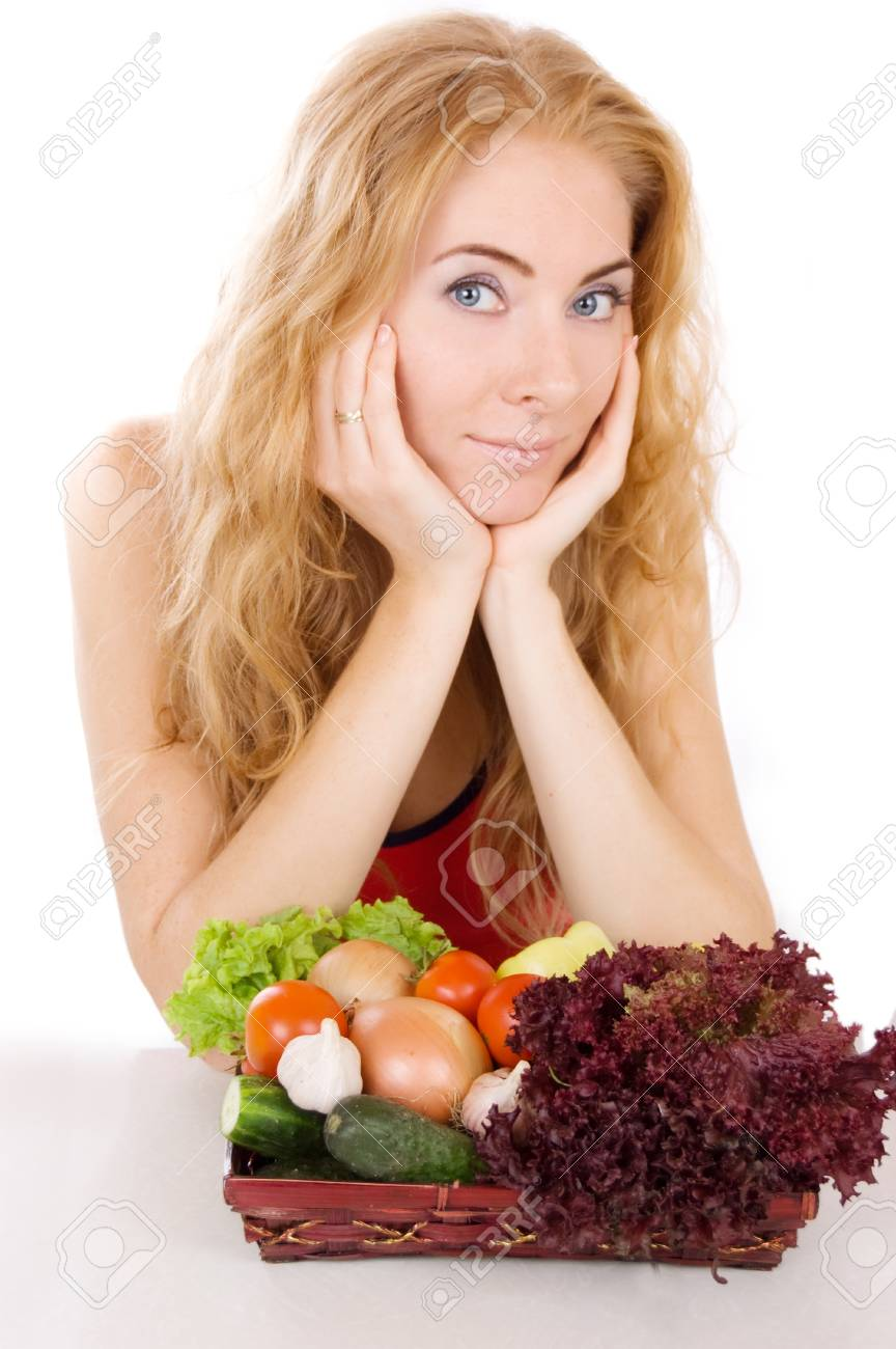 Red-headed woman with vegetables over white background Stock Photo - 11929691