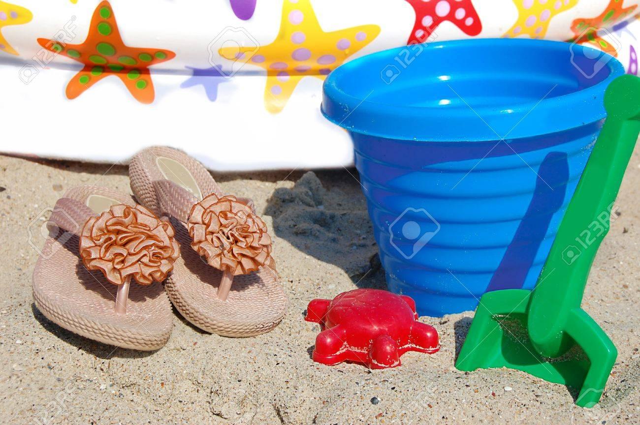 children beach toys bucket spade and shovel on sand on a sunny