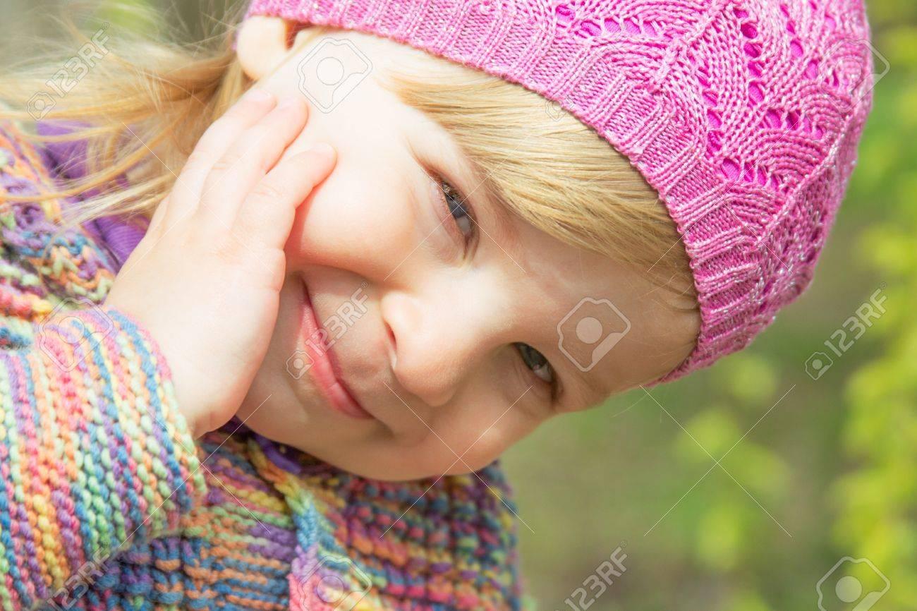 Lovely smiling baby girl face closeup outdoor Stock Photo - 13074395