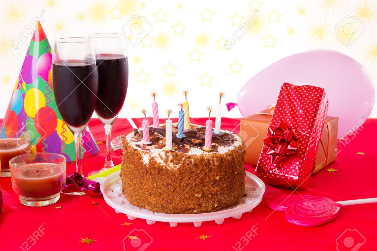 Birthday Table With Cake Candles Wine And Gifts Stock Photo