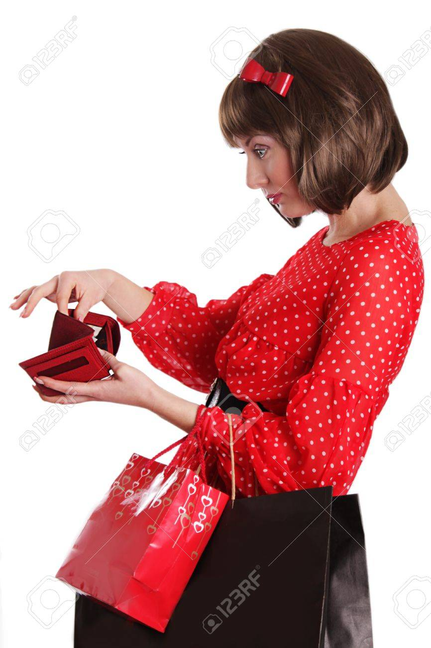 Woman with shopping bags and no money in purse over white Stock Photo - 18592860
