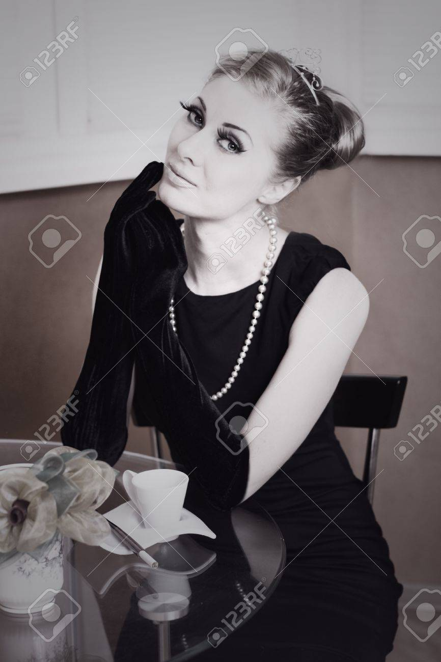Classic retro styling woman in black dress and gloves at table Stock Photo - 18766185