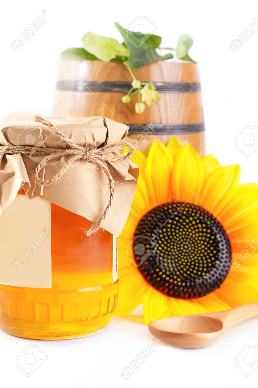 Jar and barrel with honey and flowers isolated on white Stock Photo - 20325045