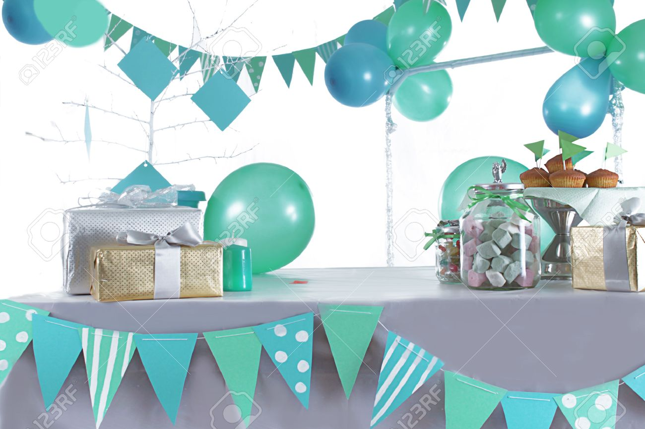 Blue And Green Colored Birthday Party Table With Sweets And