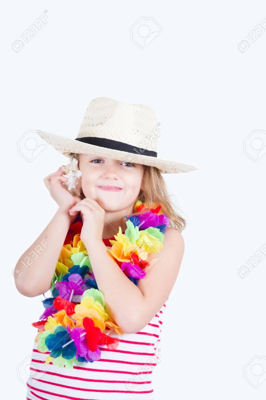 Girl with a hawaiian flower garland hears the shell noise stock girl with a hawaiian flower garland hears the shell noise stock photo 59847268 izmirmasajfo