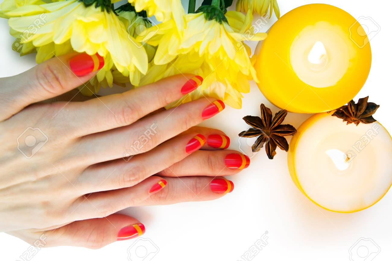 Skin care of a beauty female hands with pink and yellow striped