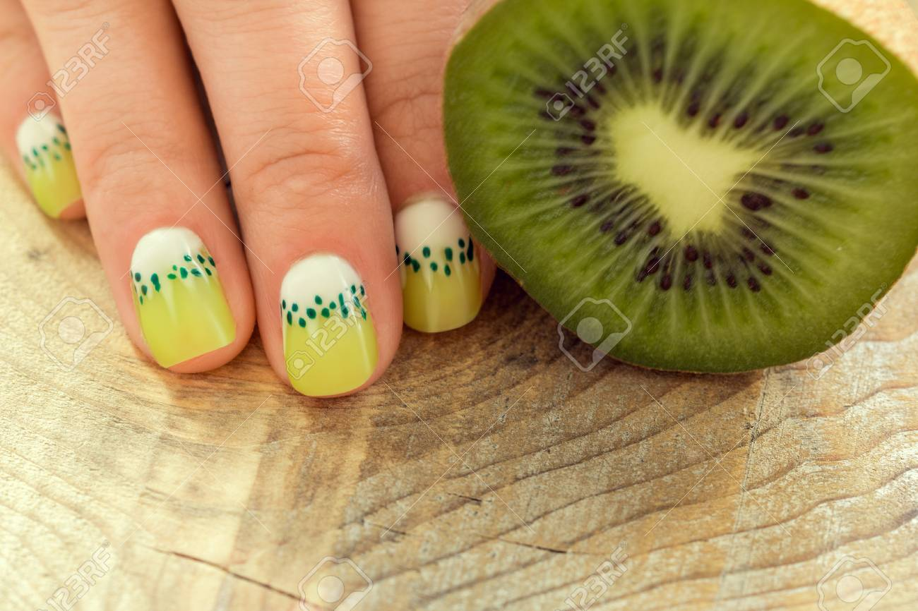 Kiwi Nail Polish And Skin Care Of A Beauty Female Hand With Stock
