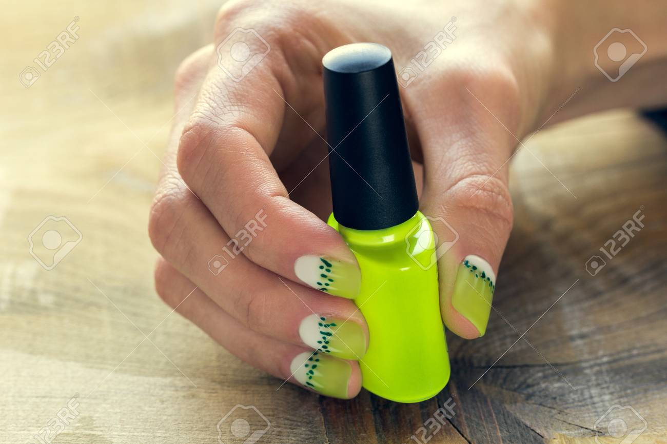 Green Nail Polish And Skin Care Of A Beauty Female Hands With