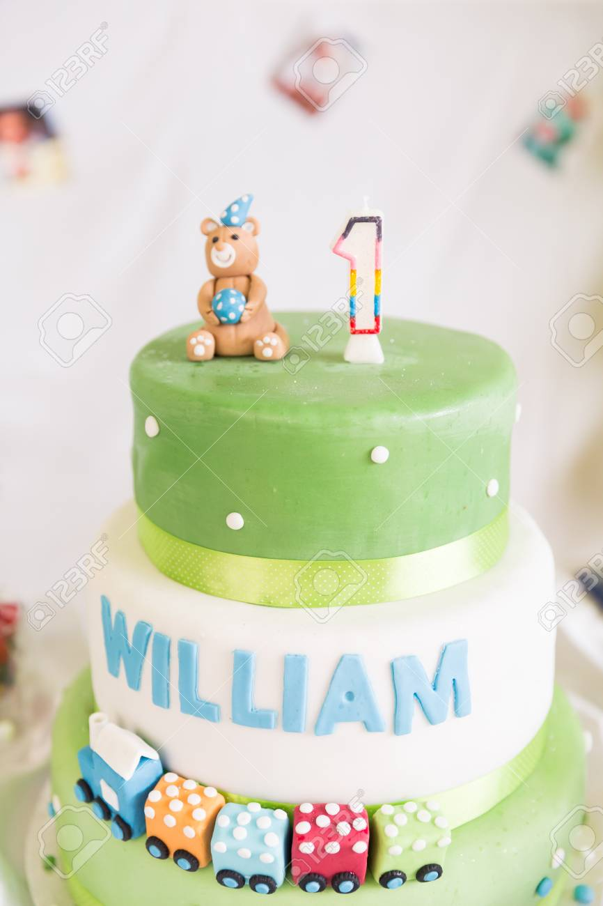 Peachy Green And White One Year Old Birthday Cake And Candle Stock Photo Funny Birthday Cards Online Elaedamsfinfo