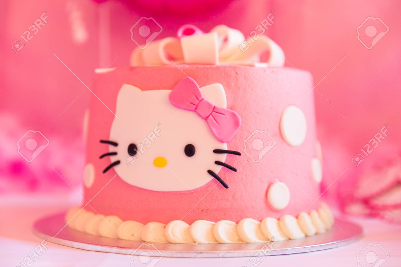 White And Pink Birthday Cake With Cat Head Blurred Background