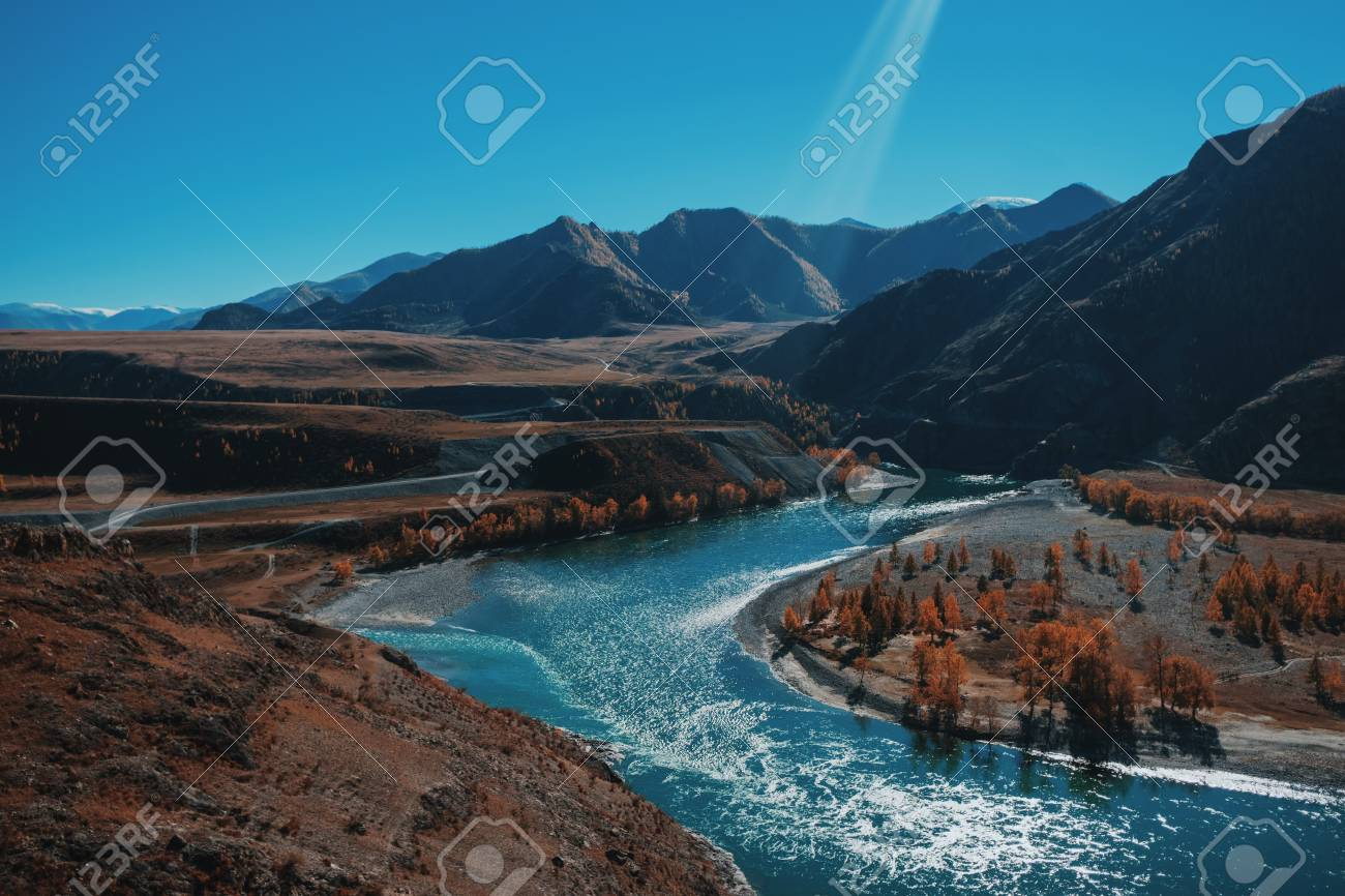 Autumn landscape with mountains and river. Blue sky - 117271905