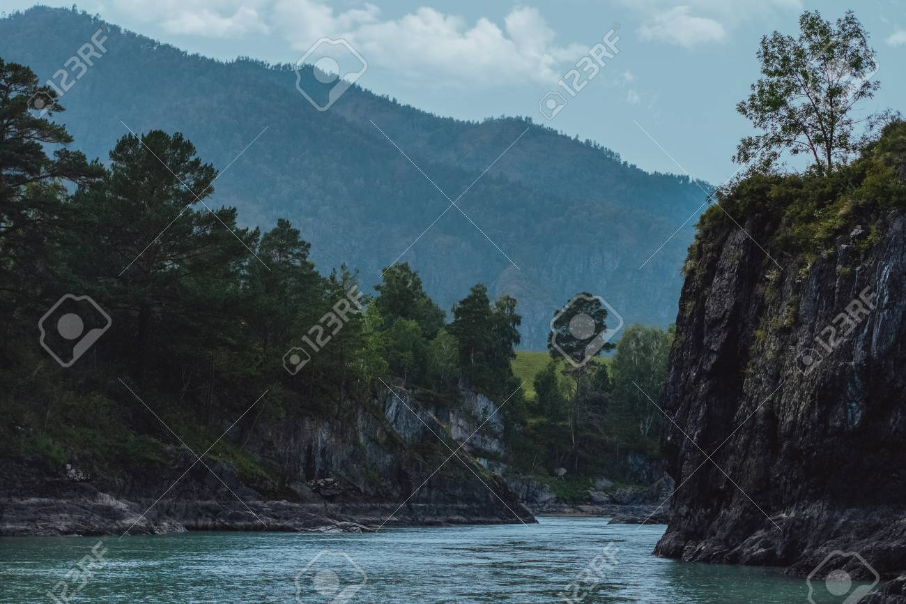 Summer landscape with mountains and river. Blue sky - 117271938