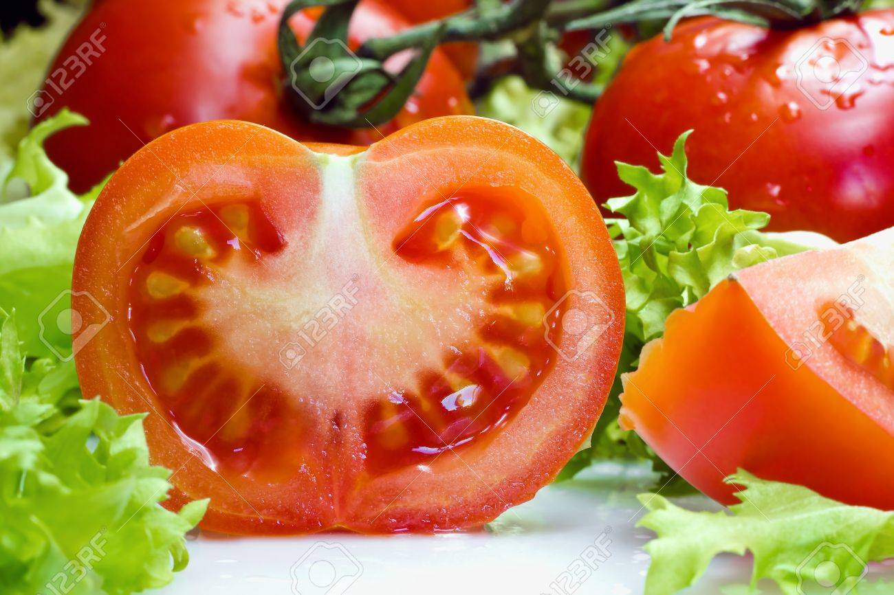close-up of a tomato with lettuce for a salad Stock Photo - 12511154