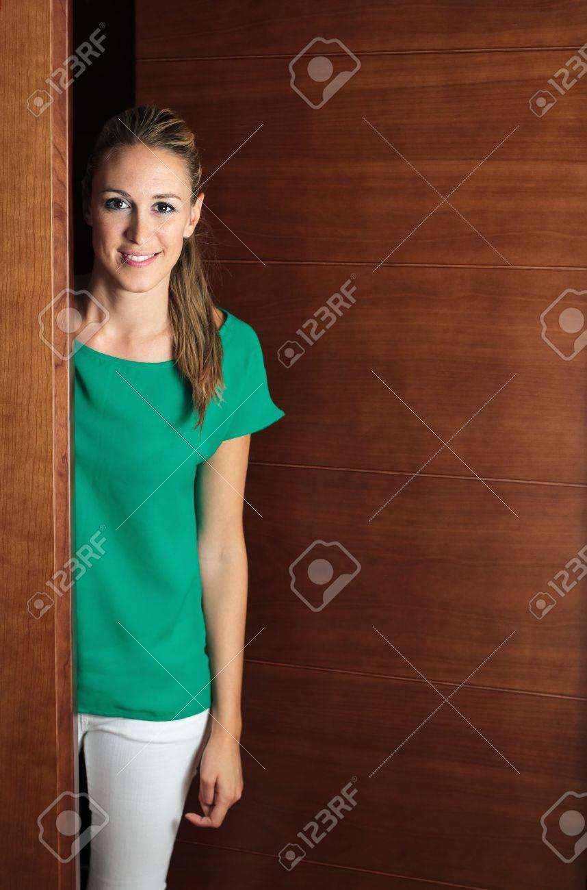 Portrait of smiling girl opening the door Stock Photo - 17890143