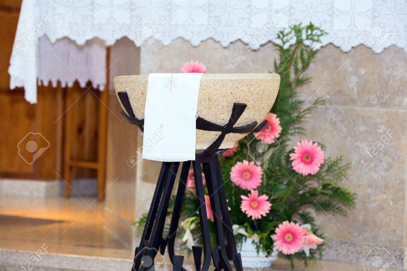 Detail of baptismal font in the church before the altar - 30558175
