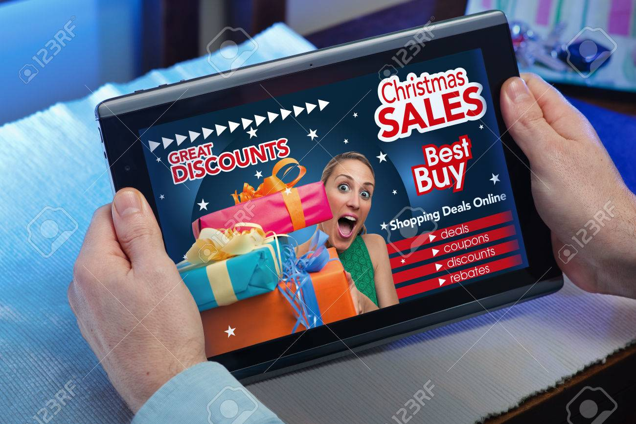 man searching website internet store to purchase Christmas presents online in christmas with your tablet in you home hands of a man in web tablet at a website with an announcement concept purchase Christmas presents online - 48034687