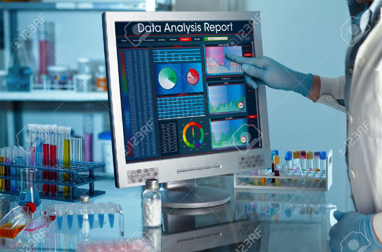 analyzing data scientist in the laboratory with a screen project development researcher touching the screen of report research data - 49101439