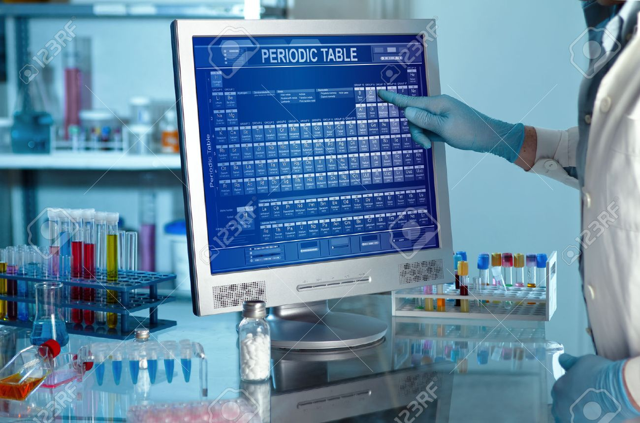 Laboratory with a researcher with periodic table on computer screen Scientific working in lab and touching a screen with the periodic table - 51327614