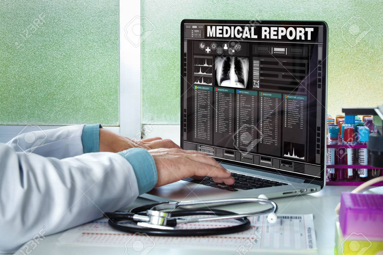 physician in consultation with a medical record of a patient on the screen of the laptop / Doctor consulting a medical history on a computer - 58852246