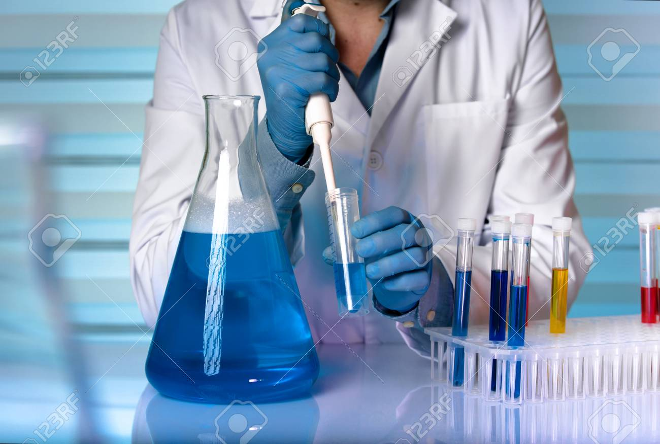 scientist working in chemical lab chemist engineer working with fluids in laboratory stock photo
