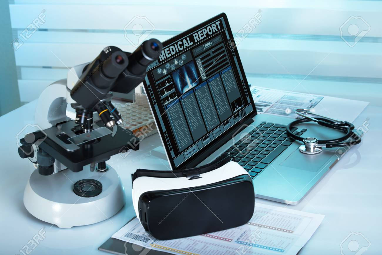 Virtual reality equipment in the laboratory / Laptop with remote diagnostic medical equipment - 66976092