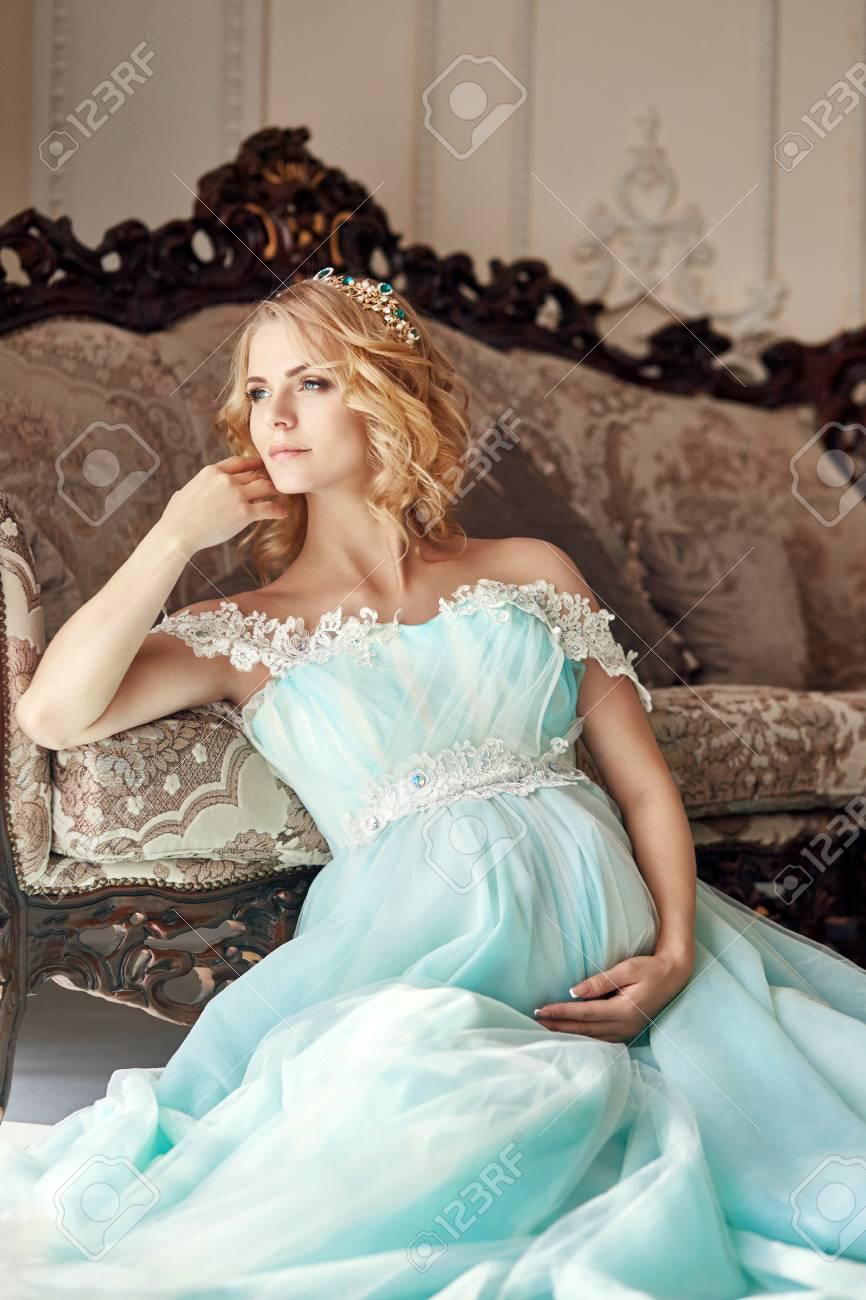 80d1c69783f20 Wedding pregnant woman. Girl is waiting the birth of a child. Elegant  expensive dress of azure color. Expectant mother and baby in belly