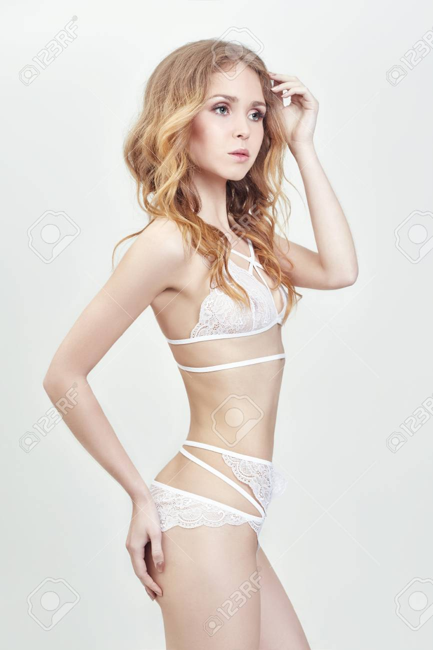 Nude woman fashion art in sexy underwear on a white background. Sensual  graceful girl with