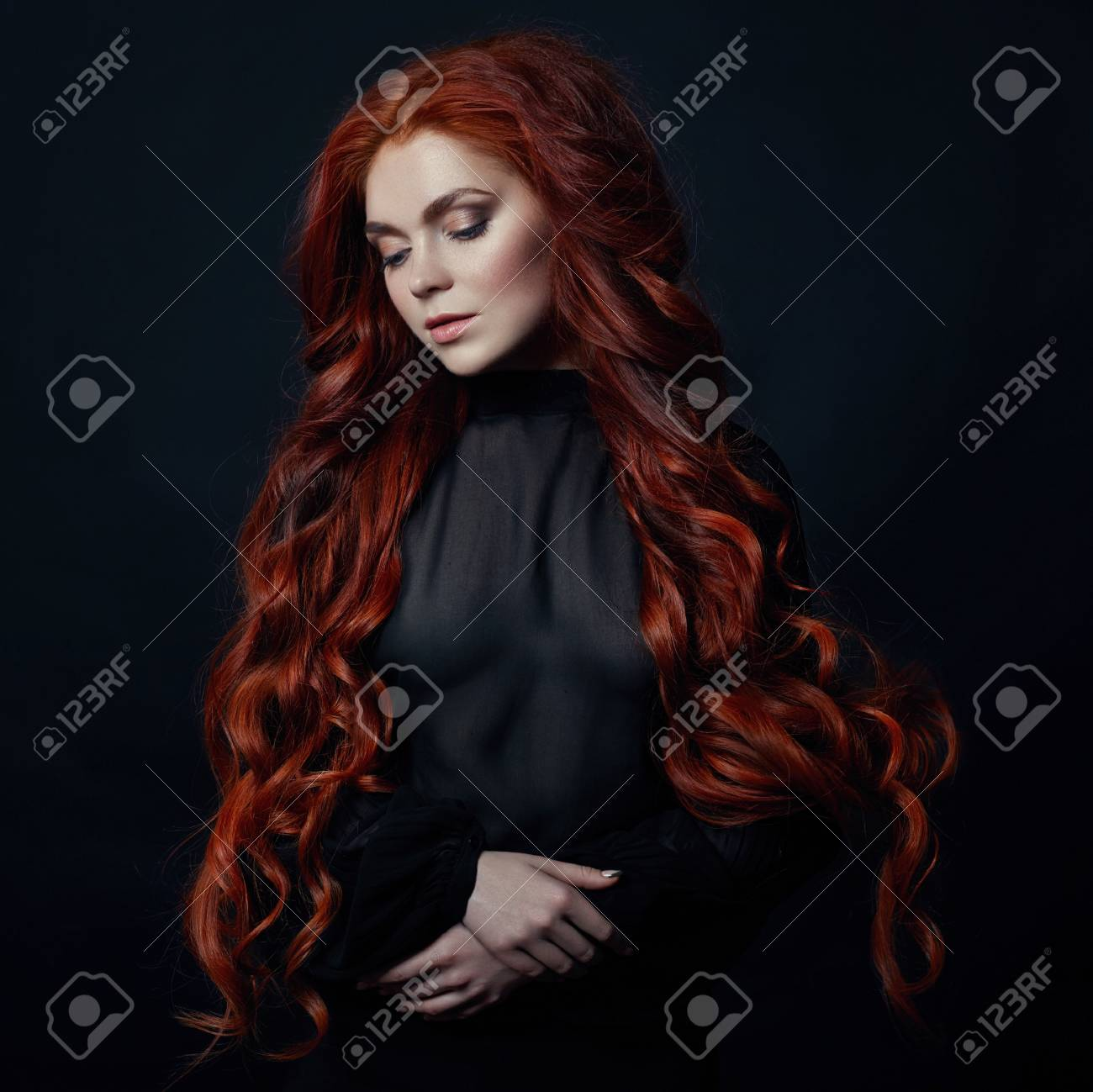 Portrait Of Redhead Sexy Woman With Long Hair On Black Background
