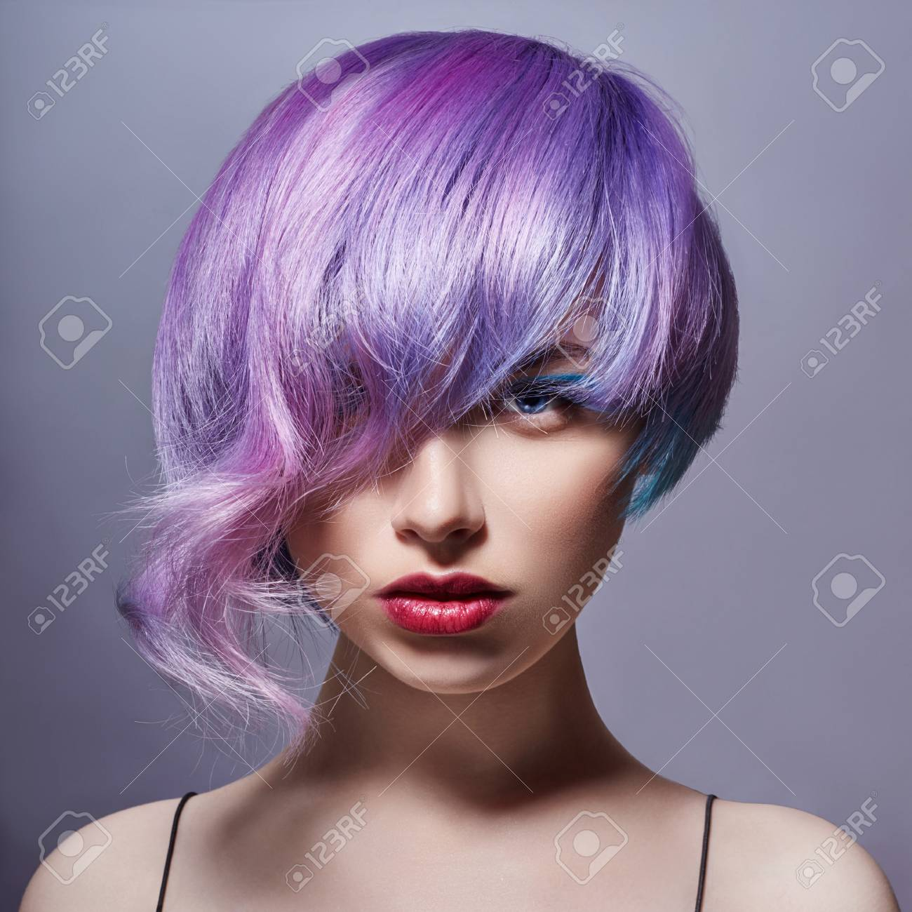 Portrait Of A Woman With Bright Colored Flying Hair All Shades