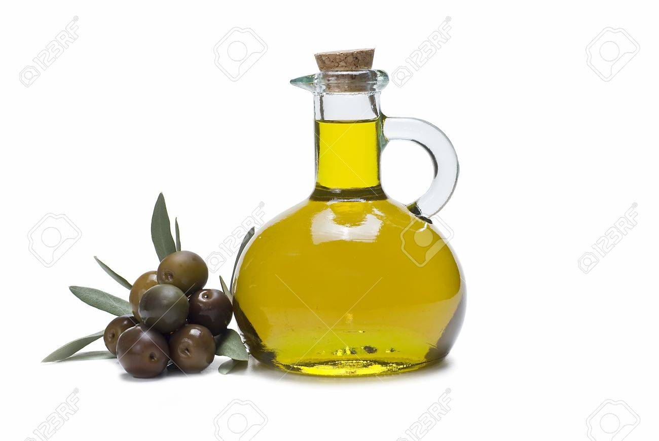 A Bottle Of Olive Oil And Some Olives On A White Background