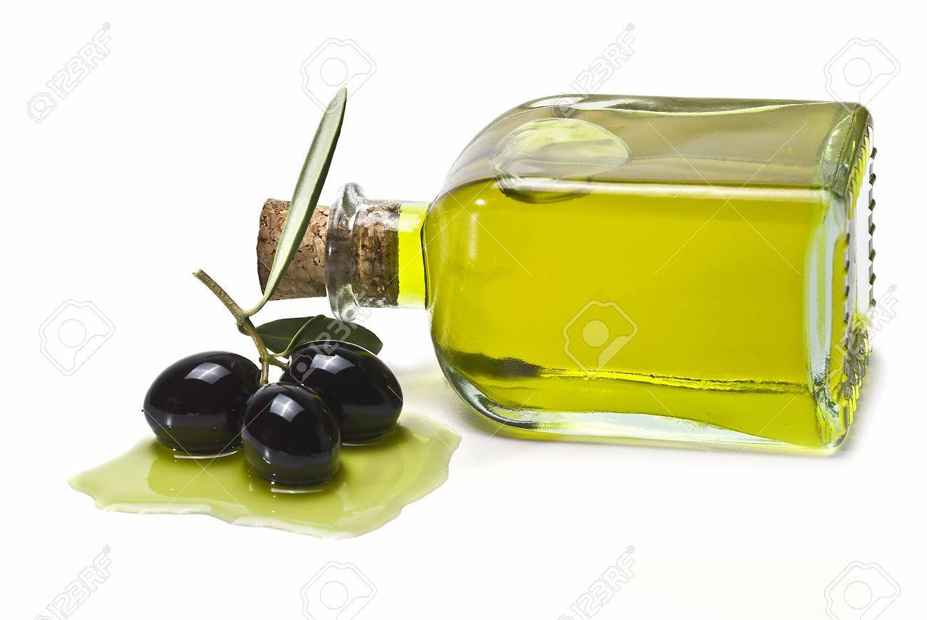 A bottle of olive oil and some black olives isolated on awhite background. Stock Photo - 8759425