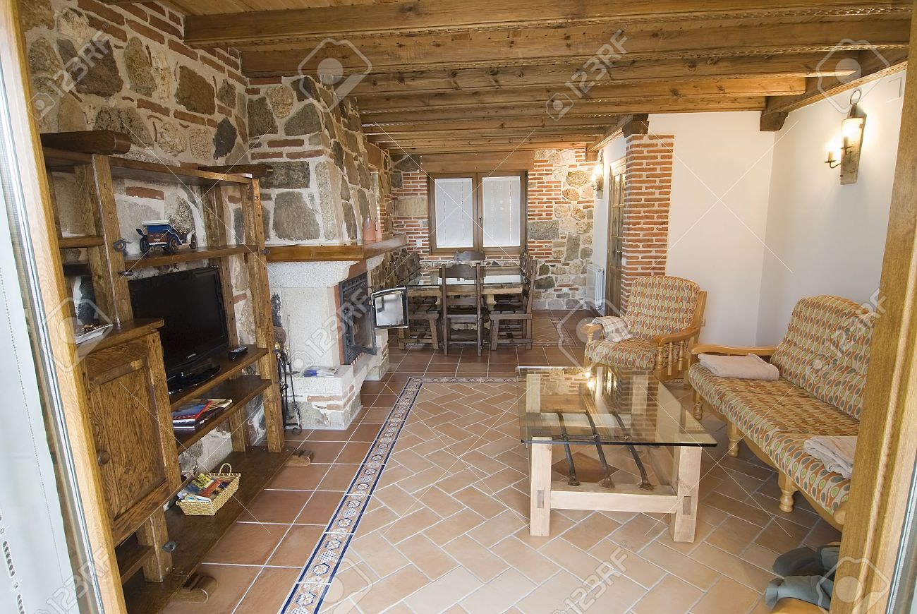 living room with fireplace in a country cottage stock photo