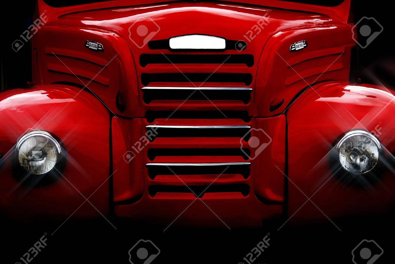 Front of an old and classic red truck recently restored. Stock Photo - 11129345