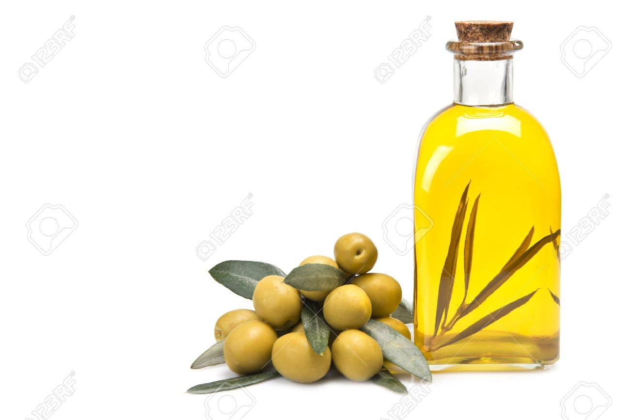 A Jar With Olive Oil And Some Green Olives Isolated Over A White